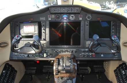 Garmin EFIS dominates the panel with standby gauges and A/P controls at the top of the glareshield.